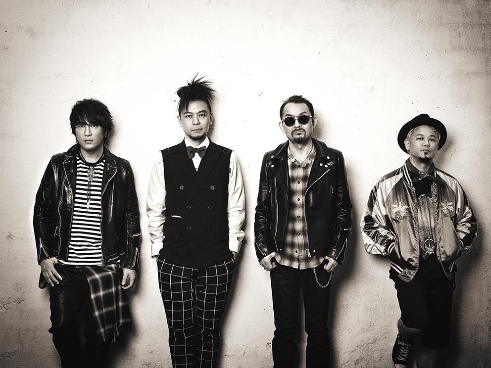 L→R 椎名慶治(Vo)、tatsu(Ba)、高橋まこと(Dr)、友森昭一(Gu)